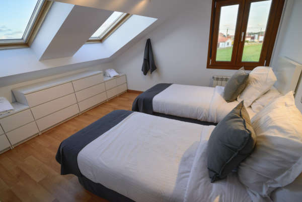 Habitación doble con velux